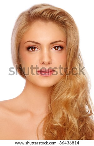 Young beautiful girl with long curly fair hair and clear make-up on white background - stock photo