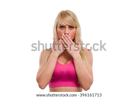 Young beautiful girl with long hair closes her mouth with her hands, isolated over white background - stock photo
