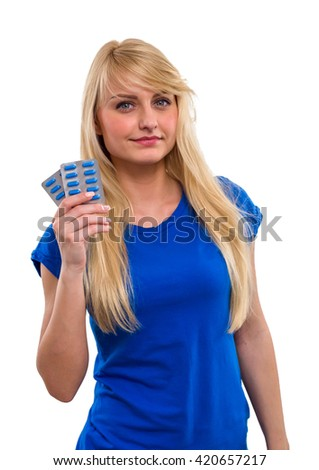 Young, beautiful girl with long hair, holds in his hand a pills, isolated on a white background - stock photo