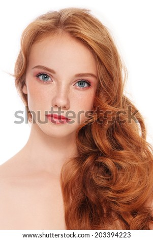 Young beautiful girl with long red hair and freckles over white background - stock photo