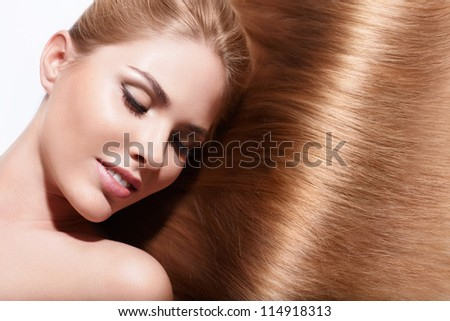 Young beautiful girl with shiny hair - stock photo
