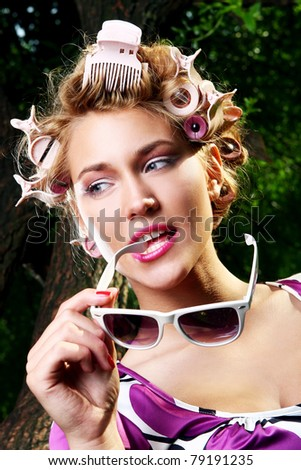 Young beautiful girl with sunglasses in park - stock photo