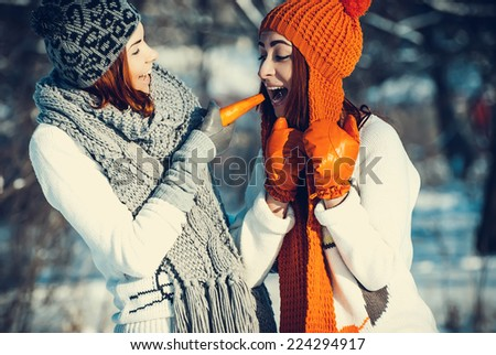 Young beautiful girls friends are in the winter forest. winter theme - stock photo