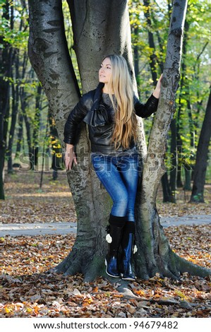Young beautiful glamour girl in a autumn park - stock photo