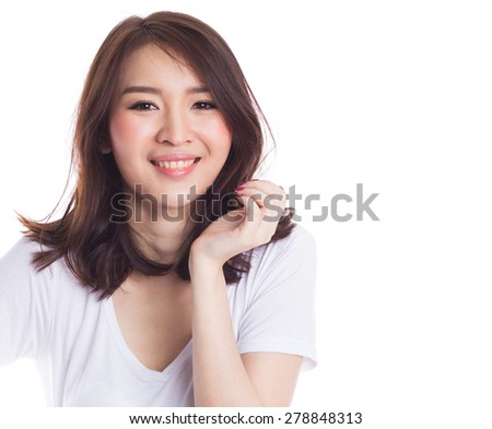 Young beautiful happy asian woman on white background - stock photo