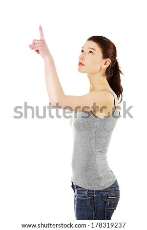 Young beautiful happy caucasian woman pointing up on copy space ,isolated on white  - stock photo