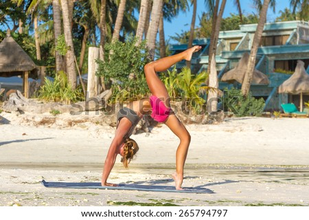 young beautiful happy smiling woman doing bodyflex, fitness, sport workout outdoors on natural background - stock photo