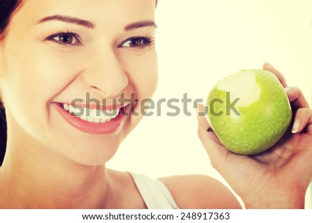 Young beautiful happy woman eating apple. - stock photo