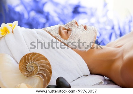 Young beautiful happy woman in spa - stock photo