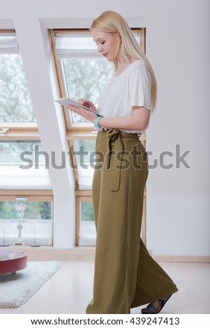 young beautiful happy woman using tablet at home - stock photo