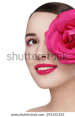 Young beautiful healthy happy smiling woman with fancy pink rose looking upwards over white background, copy space - stock photo