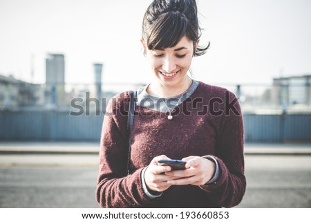 young beautiful hipster woman using smart phone in the city - stock photo