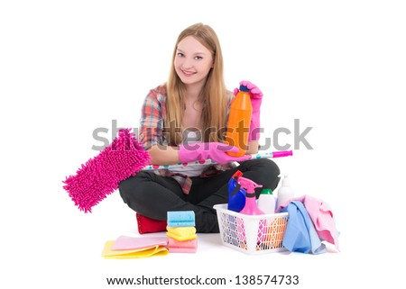 young beautiful housewife sitting with cleaning equipment isolated on white background - stock photo