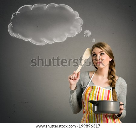 young beautiful housewife with empty think clouds, concept - What to cook today? - stock photo