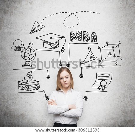 Young beautiful lady with crossed hands is going to get the master's degree in business administration. A concept of the MBA degree. Drawn educational icons on the concrete wall. - stock photo