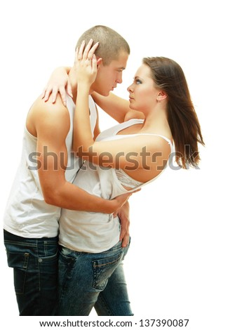 Young beautiful loving couple is embracing - on white background - stock photo