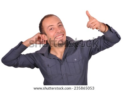 Young beautiful man thumbs up and positive attitude  - stock photo