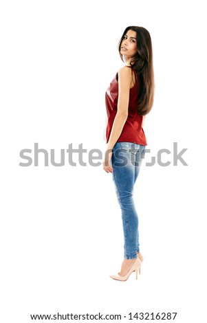 Young beautiful Middle Eastern girl with jeans and leather shirt isolated on white, full length - stock photo