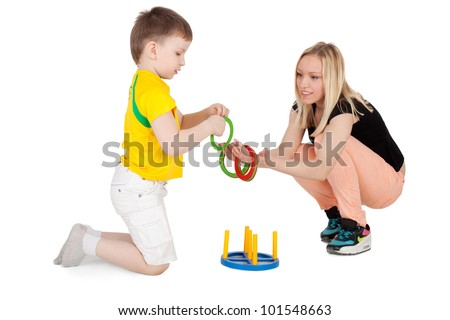 young beautiful mother playing with her child - stock photo