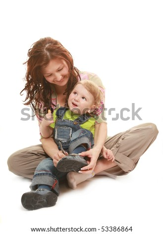 young beautiful mother tiring her little son - stock photo