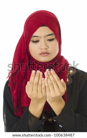 Young beautiful Muslim woman is being pray. - stock photo