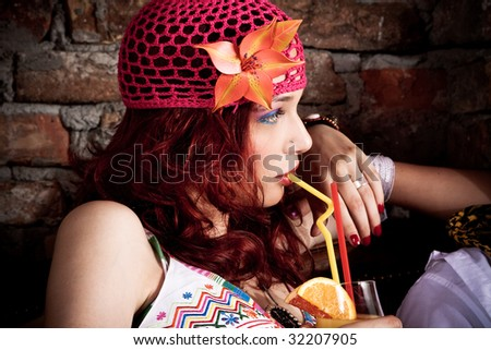 young beautiful red hair woman portrait, drins juice, profile - stock photo