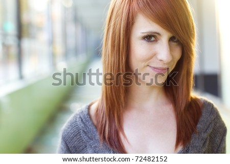 Young beautiful red haired woman portrait - stock photo