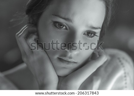 Young beautiful sad woman close-up, black-and-white image. - stock photo