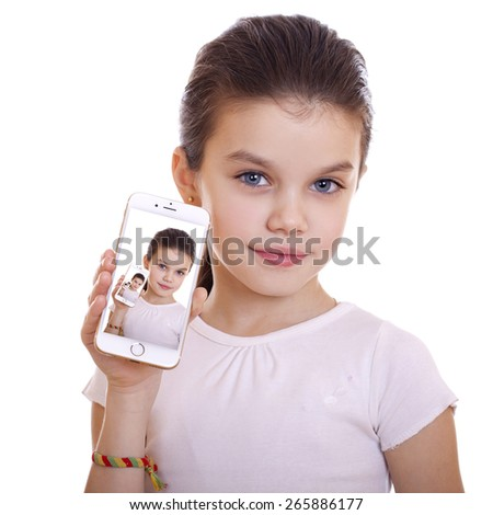 Young beautiful schoolgirl shows a new smart phone, isolated on white background - stock photo