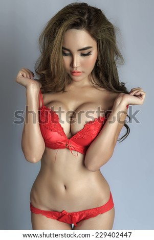 Young beautiful Sexy Asian woman wearing elegant lingerie on white background - stock photo