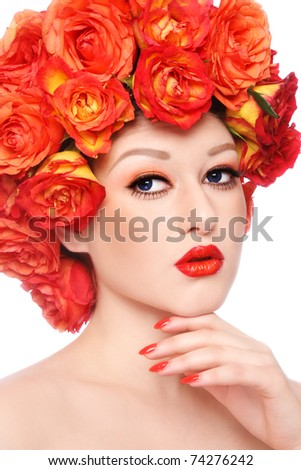 Young beautiful sexy girl with stylish orange make-up and colorful flowers around her face - stock photo