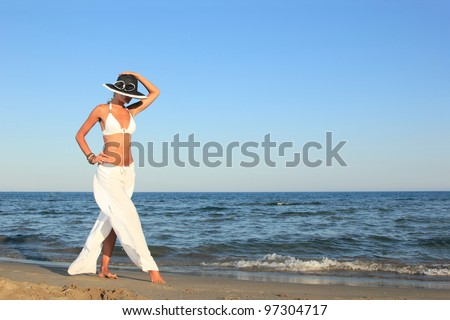 Young beautiful sexy tanned blond woman  on sea beach - stock photo