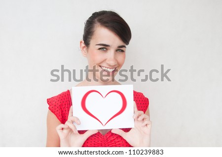 Young beautiful sexy woman showing gift card. Valentine's Day - stock photo