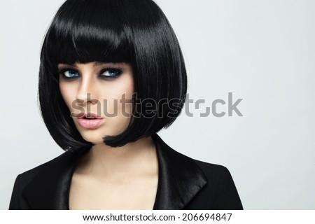 Young beautiful sexy woman with stylish bob haircut and smoky eyes - stock photo