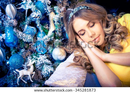 young beautiful sleeping woman with gifts on bed - stock photo