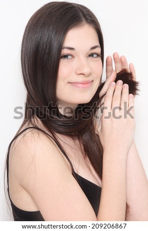 Young beautiful smiling happy girl with long healthy hair and clean make-up - stock photo