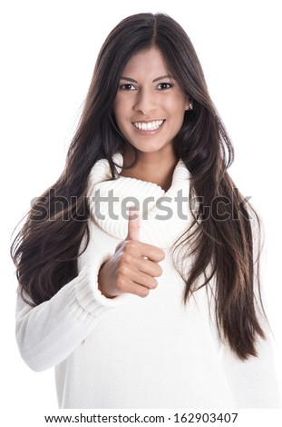 Young beautiful smiling woman isolated on a white background with a with pullover, long black hair and thumbs up. - stock photo