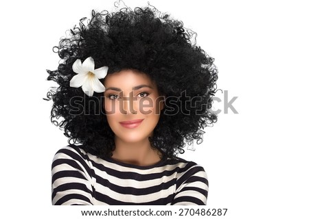 Young beautiful smiling woman wearing striped shirt with curly afro hairstyle and lily flower in hair. Beauty fashion portrait isolated on white background with copy space - stock photo