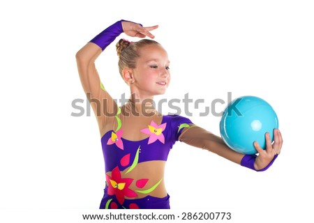 Young beautiful sport girl doing exercises with blue ball on rhythmic gymnastics event in elegant purple leotard suit dress isolated - stock photo