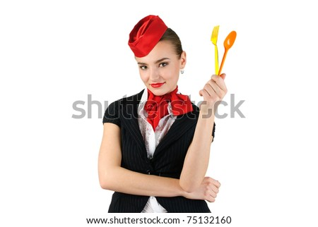 young beautiful stewardess with cutlery - stock photo