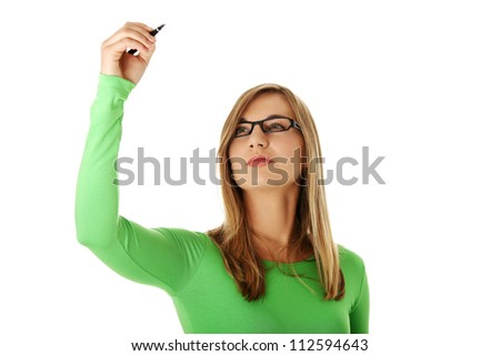 Young beautiful student woman writing with a pen on abstract screen, isolated on white - stock photo