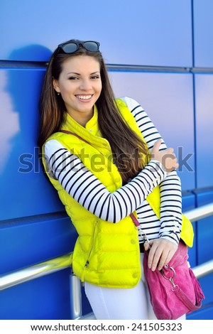 Young beautiful stylish girl with bag - stock photo