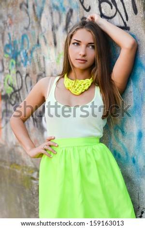 Young beautiful stylish woman street fashion happy smiling & looking at camera - stock photo