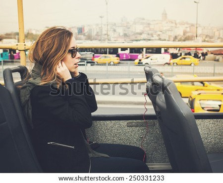 Young beautiful stylish woman traveling in tourist bus in Istanbul, Turkey - stock photo