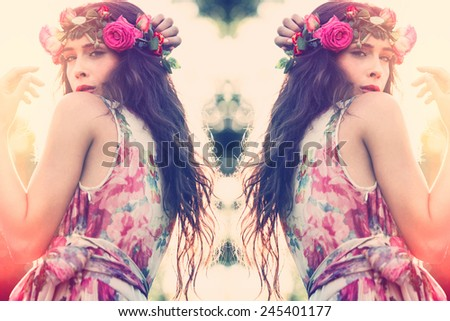 young beautiful summer woman with wreath of flowers and elegant dress  - stock photo