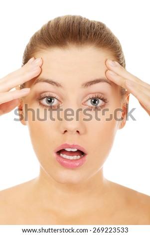 Young beautiful surprised caucasian woman. - stock photo