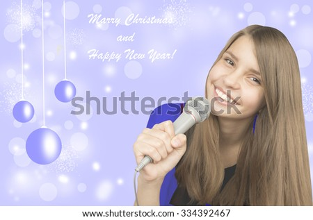 Young beautiful  teenage girl singing with a microphone - stock photo