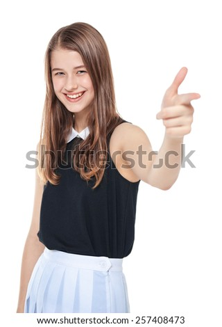 Young beautiful teenager girl showing gun sign isolated on white background - stock photo