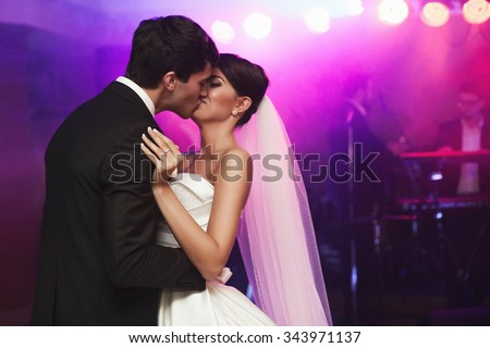 young beautiful wedding couple passionately kissing in the hall - stock photo