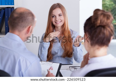 Young beautiful woman and her job interview - stock photo